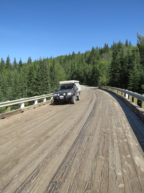 Historic Kiskatinaw Bridge - a curved timber bridge on the original Alaska Highway
