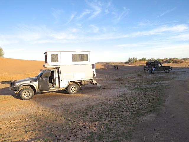 You can see them sitting just behind the cars
