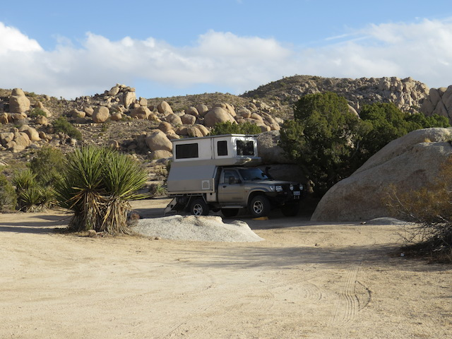 Our lovely granite boulder camp before the wind!