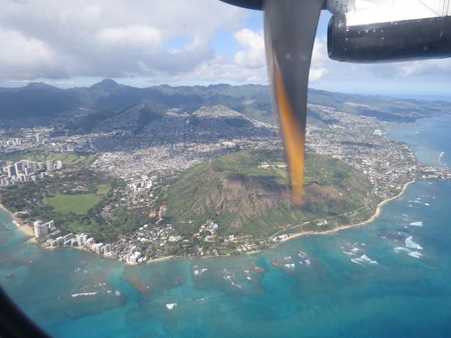 Flying over Diamond Head before arriving at Honolulu Airport